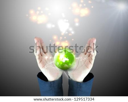 hand holding green globe - stock photo