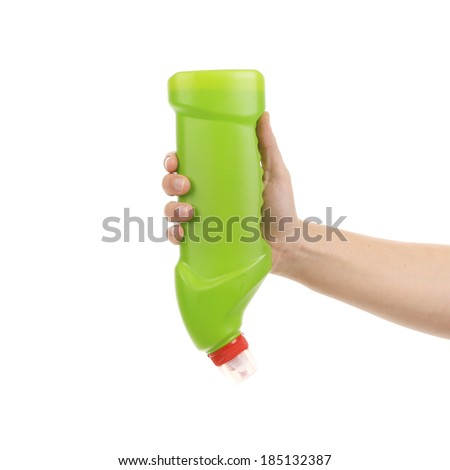 Hand holding green plastic bottle. Isolated on a white background.