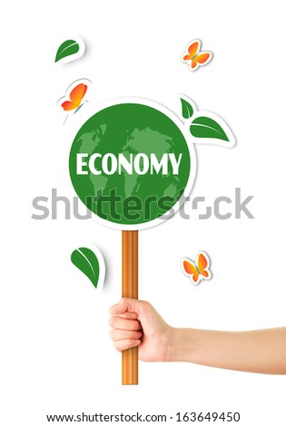 Hand holding green world sign - stock photo
