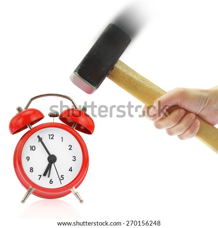 Hand holding hammer and red alarm clock,isolated on white - stock photo