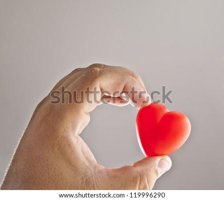 Hand holding heart - stock photo