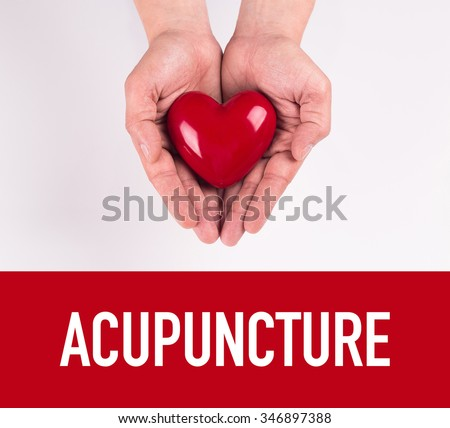 Hand holding heart shape with ACUPUNCTURE text - stock photo