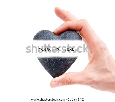 Hand holding heart with space for text - stock photo
