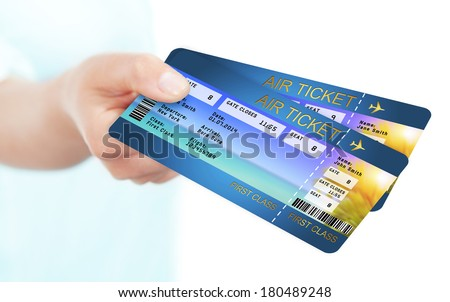 hand holding holiday airline boarding pass tickets  - stock photo