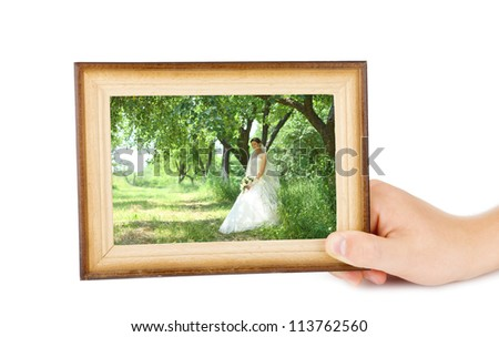 Hand holding horizontal wooden frame isolated on white with bride inside