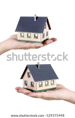 Hand holding house miniature. Home budget and finance concept
