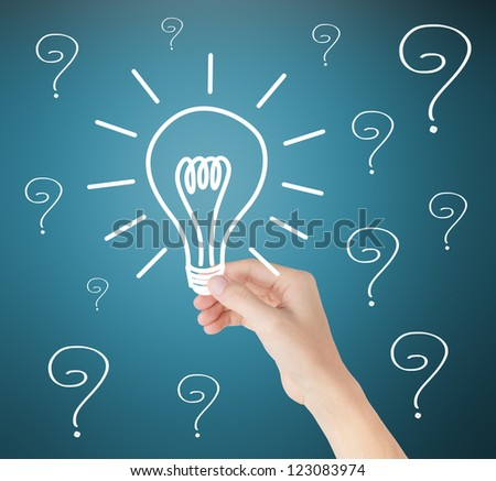 hand holding idea light bulb out of problems - stock photo