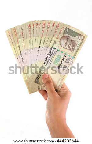 Hand holding Indian five hundred rupee notes - stock photo