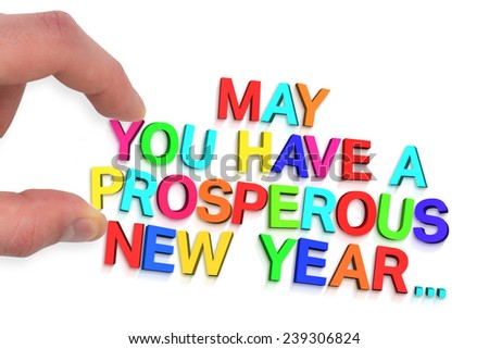 Hand holding jigsaw piece against new year greeting - stock photo