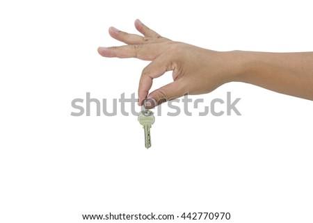 Hand holding key, isolated on white - stock photo