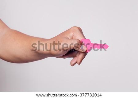 hand holding keys, gray background - stock photo