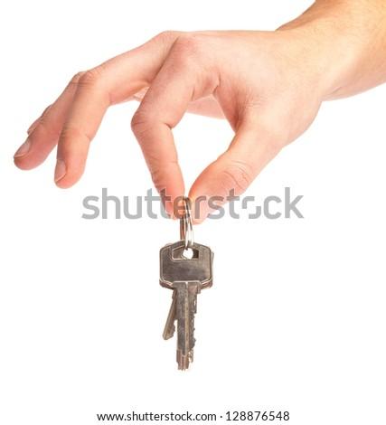 Hand Holding Keys Isolated On White Background - stock photo