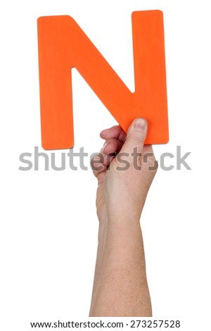 Hand holding letter N from alphabet isolated on a white background - stock photo