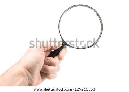 Hand holding loupe - stock photo