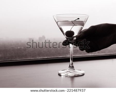 Hand holding luxurious cocktail