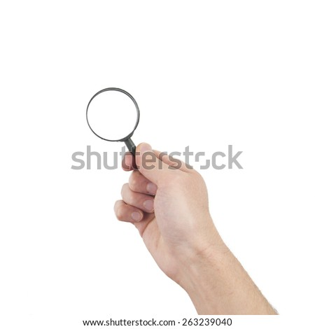 hand holding magnifier glass - stock photo