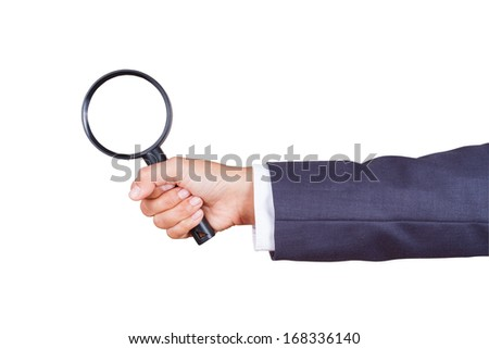 hand holding magnifier glass with using path  - stock photo