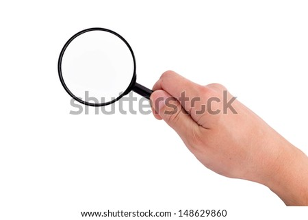 Hand holding magnifying glass