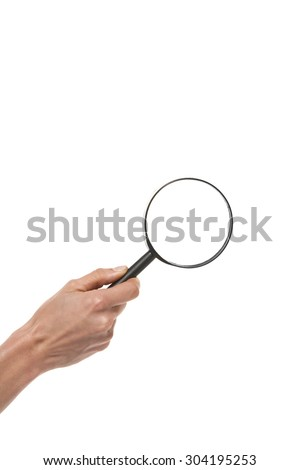 Hand holding magnifying glass - isolated on white
