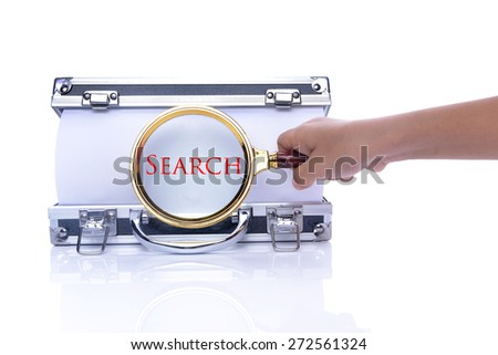 "Hand Holding Magnifying Glass on box and Write ""SEARCH"", Focus on paper."