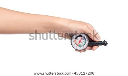 hand holding Manometer for measuring tire pressure isolated on white background
