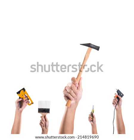 Hand holding many tools on white background - stock photo