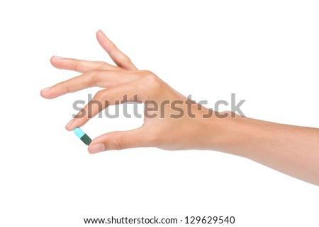 Hand holding medicine on white background - stock photo