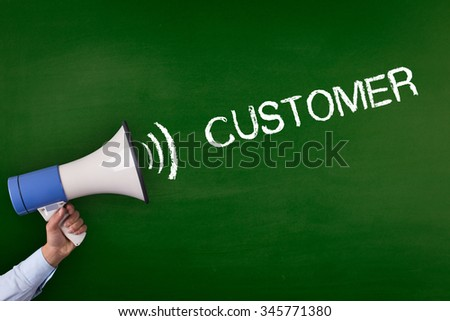 Hand Holding Megaphone with CUSTOMER Announcement - stock photo