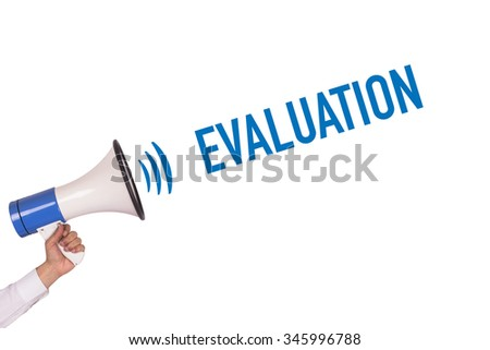 Hand Holding Megaphone with EVALUATION Announcement - stock photo