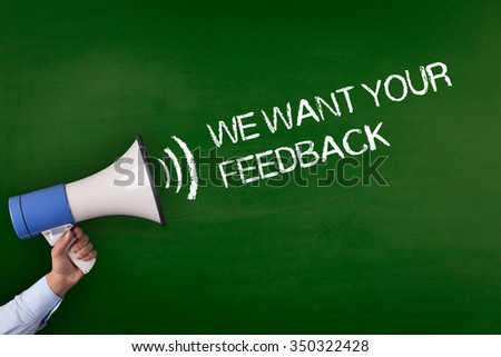 Hand Holding Megaphone with WE WANT YOUR FEEDBACK Announcement - stock photo