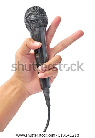 Hand holding microphone on white - stock photo