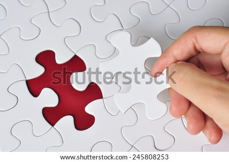 Hand Holding Missing Piece Puzzle, Selective Focus
