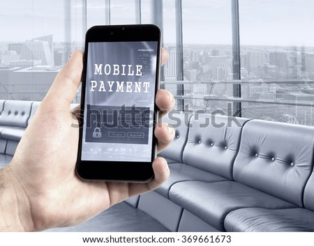 Hand holding mobile phone digital wallet concept.