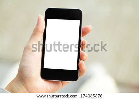 Hand holding mobile phone with blank screen - stock photo