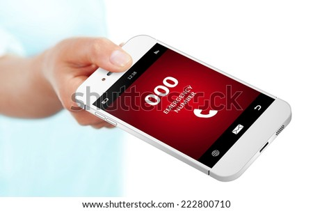 hand holding mobile phone with emergency number 000 - stock photo