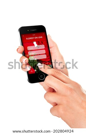 hand holding mobile phone with florist offer on screen. focus on screen - stock photo