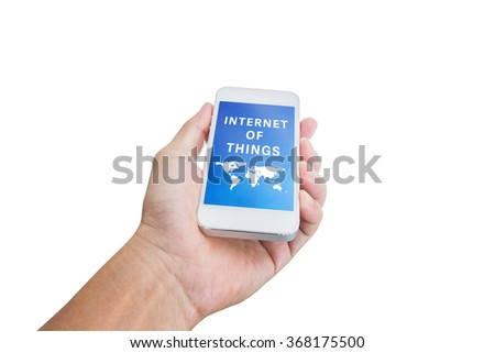 Hand holding mobile phone with Internet of things word isolated on white background; clipping path - stock photo