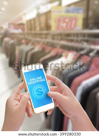 Hand holding mobile phone with Online shopping on screen for E-commerce business concept - stock photo