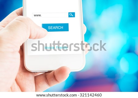 Hand holding mobile phone with search page on screen with mobile friendly feature at blurred blue background, Search engine business concept. - stock photo