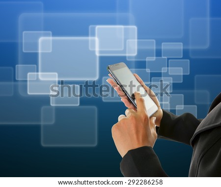 Hand holding mobile phone with streaming images. - stock photo