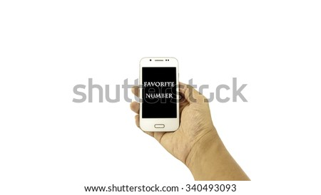 Hand holding mobile phone with written ??FAVORITE NUMBER?? on black background against white background. Communication concept. Selective focus and shallow of Depth of Field.