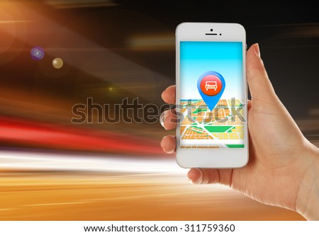 Hand holding mobile smart phone with interface taxi on night background - stock photo