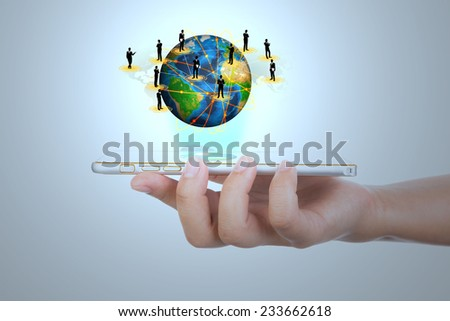 Hand holding Modern communication technology mobile phone show the social network (Elements of this image furnished by NASA) - stock photo