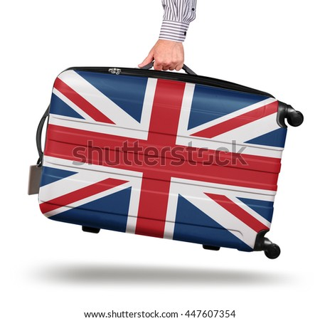 Hand holding modern suitcase Union Jack design isolated on white Brexit concept - stock photo