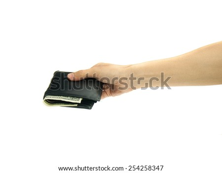 Hand holding money bag isolated on white background.
