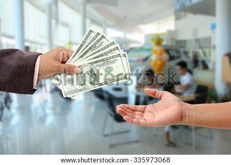 Hand holding money ,concept of finance for car. - stock photo