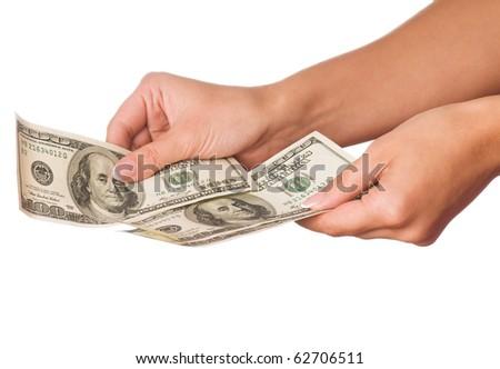 Hand holding money dollars isolated on white background - stock photo