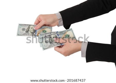 Hand holding money in dollars isolated on white background