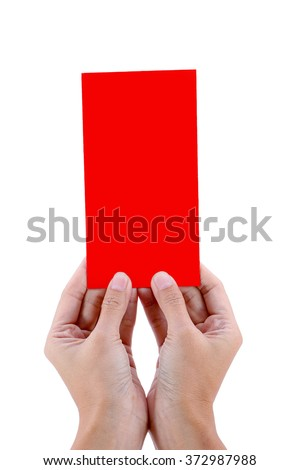 Hand holding money in the Chinese New Year red envelopes on white background.