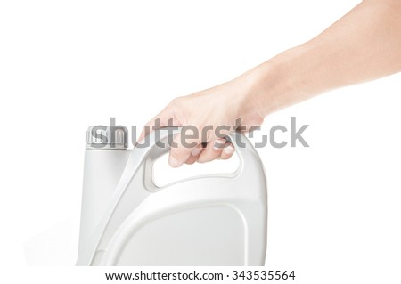 Hand holding motor oil on white background - stock photo